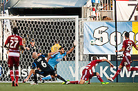 FC Dallas goalkeeper Raul Fernandez (1) dives for a shot. The Philadelphia Union and FC Dallas played to a 2-2 tie during a Major League Soccer (MLS) match at PPL Park in Chester, PA, on June 29, 2013.