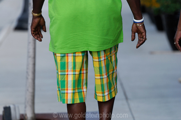 Man with bright green shirt and colorful shorts in Manassas, VA