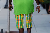 Man with bright green shirt and colorful shorts in Manassas, VA