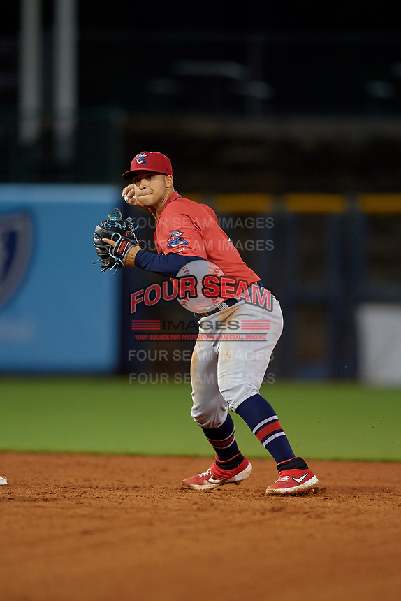 Jacksonville Jumbo Shrimp shortstop Joe Dunand (3) attempts to turn a double play during a Southern League game against the Mississippi Braves on May 4, 2019 at Trustmark Park in Pearl, Mississippi.  Mississippi defeated Jacksonville 2-0.  (Mike Janes/Four Seam Images)
