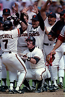 SAN FRANCISCO, CA:  Matt Williams and Kevin Mitchell of the San Francisco Giants celebrate at home plate after Mitchell hit a game-winning home run in 10th inning vs Cincinnati Reds at Candlestick Park in San Francisco, California on June 8, 1990. (Photo by Brad Mangin)