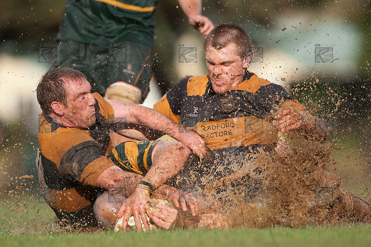 Pat Clotworthy and Connall Bromwich manage to stop Kevin Farrells slide to the trline.  Counties Manukau Premier Club Rugby game between Pukekohe and Bombay played in very wet conditions at Colin Lawrie Fields Pukekohe on Saturday 18th June 2011. Pukekohe won 61 - 0 after leading 31 - 0 at halftime.