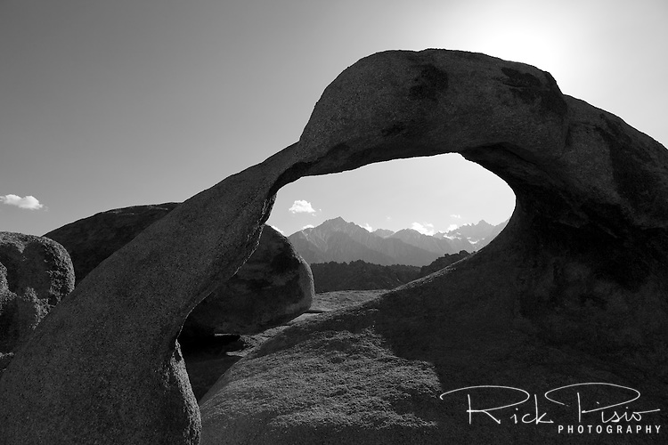"Mobius Arch, in California's Alabama Hills State Recreation Area forms a portal to view  Lone Pine Peak and Mount Whitney. Since the 1920's film makers have been using the Alabama Hills as a backdrop for their movies. In the early days of motion pictures films such as ""Gunga Din"", ""How the West Was Won"", and ""Yellow Sky"" were filmed at a site within the recreation area known as ""Movie Flats. More recently movies such as ""Tremors"", ""Star Trek Generations,"" ""Gladiator"", ""Iron Man"", and ""Django Unchained"" were shot in the Alabama Hills."