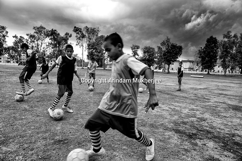 Children of Sukma Football academy practice skills at the ground of Sukma Educational Hub. Sukma, Chattisgarh, India. Arindam Mukherjee