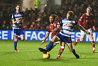 Bobby Reid of Bristol City is challenged by Paul McShane of Reading during the Sky Bet Championship match between Bristol City and Reading at Ashton Gate, Bristol, England on 26 December 2017. Photo by Paul Paxford.