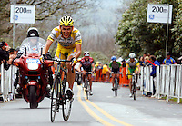 Marco Pinotti, of Prodir-Saunier Duval, climbs a 24-percent-grade section of Brasstown Bald during Stage 5 of the Ford Tour de Georgia. Tom Danielson, of the Discovery Channel Pro Cycling Team, won the 94.5-mile (152.1-km) stage from Blairsville to the top of Brasstown Bald, the highest point in the state. Pinotti finished 10th.<br />