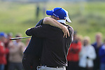 David Mortimer hugs his caddy after sinking his putt to win on the 18th green during the Final Day of the 100th Irish PGA Championship at Seapoint Golf Club, Co. Louth, 26th September 2010..(Picture Eoin Clarke/www.golffile.ie)