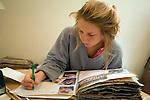 Model released image of teenage girl working on her art folder