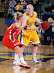 BROOKINGS, SD - NOVEMBER 20th, 2008 : Macie Michelson of South Dakota State looks past Utah defender Hannah Stephens during the first half of their game Thursday evening at Frost Arena on the campus of South Dakota State University in Brookings, SD. (Photo By Ty Carlson/Inertia)