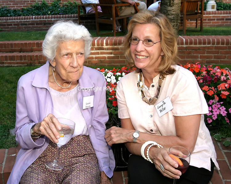 WATERBURY, CT, 14 July 2006- 071406BZ07- From left-  Leonie Parsons, of Roxbury, a friend of the Calder family, and Georgette Miller, of Roxbury, <br /> <br /> during an event highlighting the work of Roxbury artist Alexander Calder (1898-1976) at the Mattatuck Museum Arts and History Center in Waterbury Friday evening. Calder worked with several Waterbury metal fabricating companies to construct his pieces.<br /> Jamison C. Bazinet Republican-American