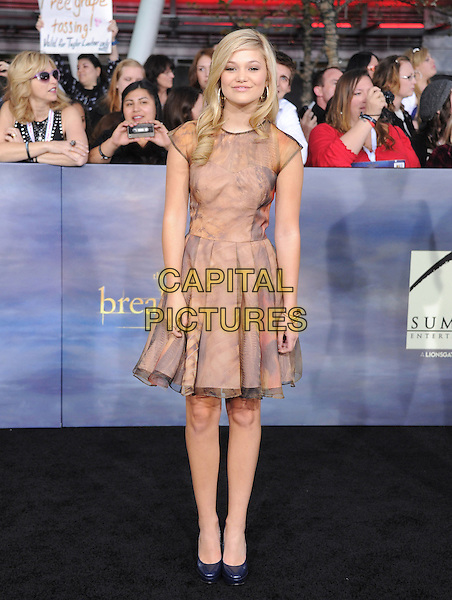 """Olivia Holt.""""The Twilight Saga: Breaking Dawn - Part 2"""" Los Angeles Premiere held at Nokia Theatre L.A. Live, Los Angeles, California, USA..November 12th, 2012 .full length beige pink tie dye dress.CAP/DVS.©DVS/Capital Pictures."""