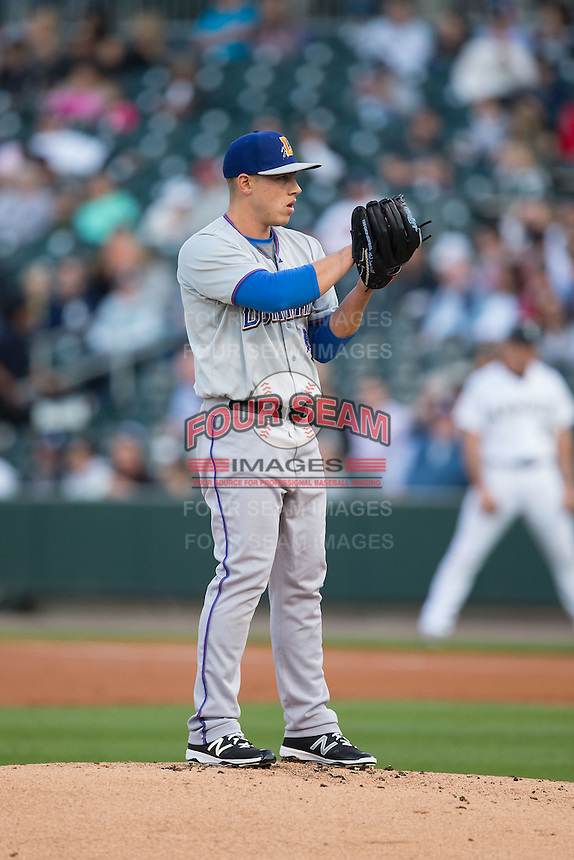 Durham Bulls starting pitcher Jaime Schultz (12) looks to his catcher for the sign against the Charlotte Knights at BB&T BallPark on April 14, 2016 in Charlotte, North Carolina.  The Bulls defeated the Knights 2-0.  (Brian Westerholt/Four Seam Images)