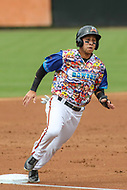 Bowie, MD - May 21, 2017: Bowie Baysox shortstop Erick Salcedo (9) scores a run during the MiLB game between Binghamton and Bowie at  Baysox Stadium in Bowie, MD.  (Photo by Elliott Brown/Media Images International)