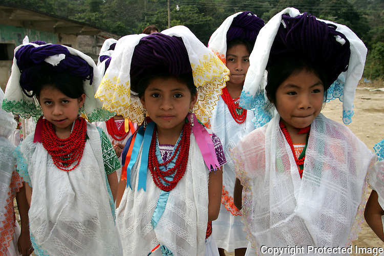 Naua Indian girls in full-colored clothes make her way to school in her village of Ayotzinapan, Puebla. Photo by Heriberto Rodriguez/ CGEIB