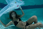 Young girl in pool, black bikini, underwater photography, underwater Model.