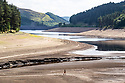 11/07/18<br /> <br /> Howden dam (in the distance) with dried up reservoir..<br /> <br /> Water levels in the Derbyshire Peak District have dropped to reveal a landscape close to how it would have looked before the Howden, Derwent and Ladybower dams were built in the early 1900s and 1940s. <br /> <br /> All Rights Reserved, F Stop Press Ltd. (0)1335 344240 +44 (0)7765 242650  www.fstoppress.com rod@fstoppress.com