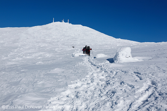 A group of winter hikers use the Crawford Path (Appalachian Trail) to ascend Mount Washington in the White Mountains, New Hampshire during the winter months. Mount Washington, at 6,288 feet, is the tallest mountain in the northeastern United States. And the Appalachian Trail travels over the summit of this mountain.
