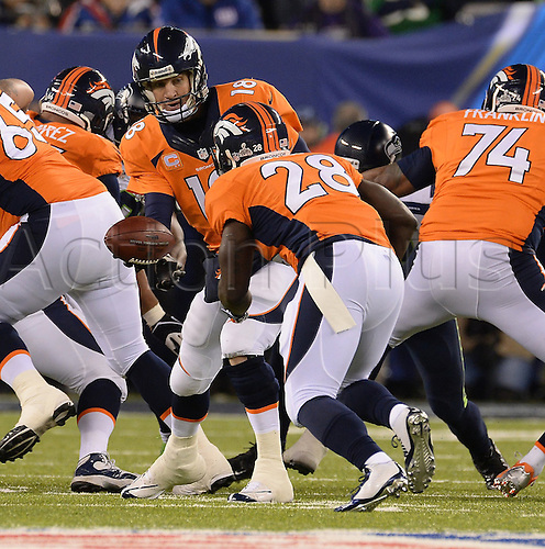 02.02.2014. East Rutherford, NJ, USA. Denver Broncos quarterback Peyton Manning (18) hands off to running back Montee Ball (28) against the Seattle Seahawks in the second quarter of Super Bowl XLVIII at MetLife Stadium in East Rutherford, N.J., on Sunday, Feb. 2, 2014