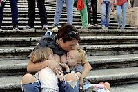 Roma, 3 Ottobre 2015<br /> Mamma allatta contemporaneamente due bambine.<br /> Mamme allattano al seno in un flash mob a Piazza di Spagna durante la settimana mondiale per promuovere e difendere l'allattamento al seno.<br /> Allattamento e lavoro.<br /> L'iniziativa &egrave; promossa da MAMI, Movimento Allattamento Materno Italiano<br /> Flash mob with breastfeeding collective to promote breastfeeding.