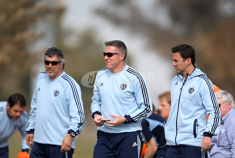 Jan. 25, 2013; Casa Grande, AZ, USA: Sporting KC head coach Peter Vermes (center) against the New England Revolution during a preseason game at Grande Sports World. Mandatory Credit: Mark J. Rebilas-USA TODAY Sports