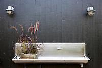A contemporary, metallic sink for use in the garden