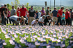 Several hundred people participate in a Veterans Suicide Awareness walk to Western Nevada College in Carson City, Nev., on Saturday, May 2, 2015. After walking from Bully's Sports Bar, participants added flags to a display signifying the more than 8,000 veteran suicides each year in the U.S. <br /> Photo by Cathleen Allison/Nevada Photo Source