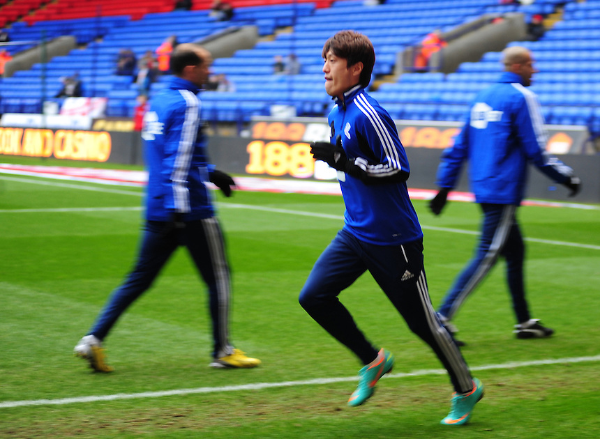 Bolton Wanderers' Lee Chung-Yong during the warm up..Football - npower Football League Championship - Bolton Wanderers v Charlton Athletic - Saturday 15th December 2012 = The Reebok Stadium - Bolton..