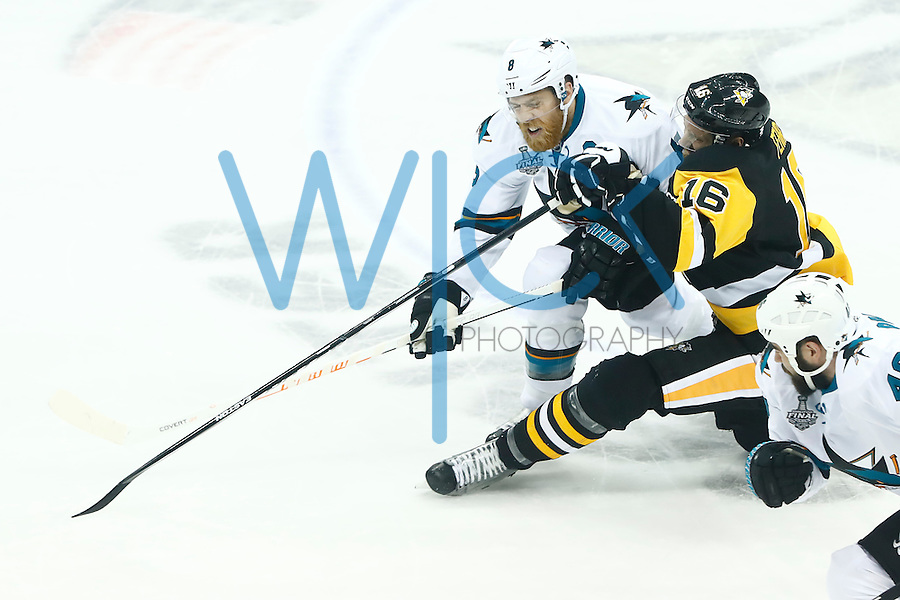 Eric Fehr #16 of the Pittsburgh Penguins is hit by Joe Pavelski #8 of the San Jose Sharks in the second period during game five of the Stanley Cup Final at Consol Energy Center in Pittsburgh, Pennsylvania on June 9, 2016. (Photo by Jared Wickerham / DKPS)