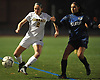 Allison Seidman #2 of Commack, left, gets pressured by Nataly Ramirez #7 of Seaford during Game 1 of two Long Island varsity girls soccer senior all-star games at Farmingdale State College on Friday, Nov. 24, 2017.