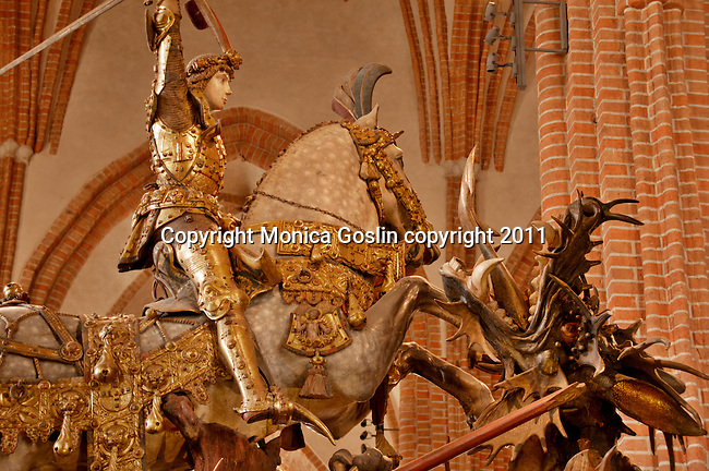 Statue of Saint George slaying the dragon in the Stockholm Cathedral, Sweden; the statue is from the late 15th century and carved out of oak and elk antlers decorate the dragon
