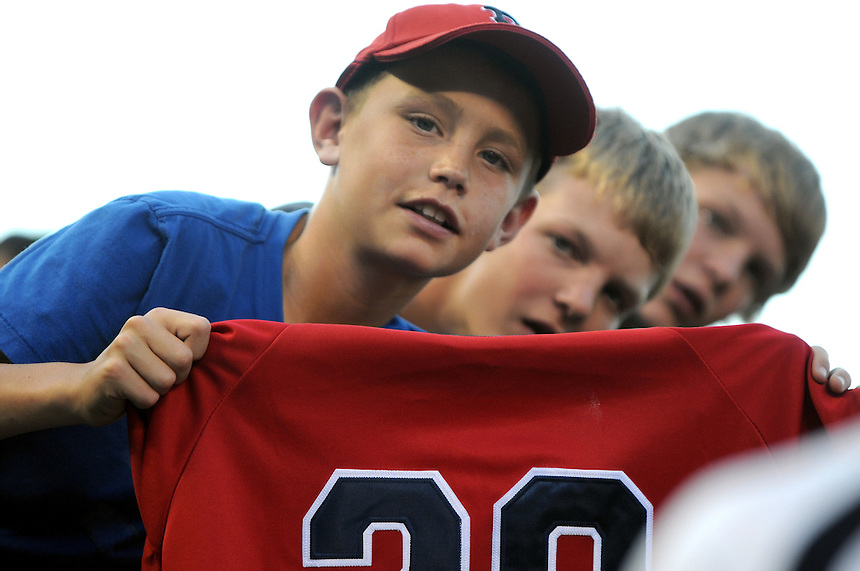 22 JUNE 2010: Young Boston Red Sox fans cheer and ask for autographs during an interleague regular season Major League Baseball game between the Colorado Rockies and the Boston Red Sox at Coors Field in Denver, Colorado. The Rockies beat the Red Sox 2-1.  *****For Editorial Use Only*****