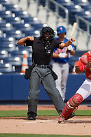 Home plate umpire Emma Charlesworth-Seiler calls strike three during the first game of a doubleheader between the GCL Mets and GCL Nationals on July 22, 2017 at The Ballpark of the Palm Beaches in Palm Beach, Florida.  GCL Mets defeated the GCL Nationals 1-0 in a seven inning game that originally started on July 17th.  (Mike Janes/Four Seam Images)