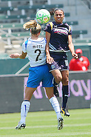 Marta #10 of the Los Angeles Sol collides with Heather Mitts of the Boston Breakers during thier WPS game at Home Depot Center on May 10, 2009 in Carson, California.