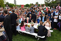 First Lady Melania Trump (R) and United States President Donald J. Trump make cards for members of the military at the annual Easter Egg roll on the South Lawn of the White House in Washington, DC, on April 17, 2017. <br /> CAP/MPI/CNP/RS<br /> &copy;RS/CNP/MPI/Capital Pictures