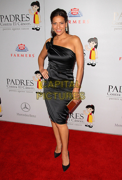 CONSTANCE MARIE.The 7th Annual El Sueno de Esperanza Benefit Gala to raise funds for Padres Contra El Cancer held at The Lot in West Hollywood, California, USA..October 18th, 2007.full length black dress one shoulder corsage gold clutch purse hand on hip.CAP/DVS.©Debbie VanStory/Capital Pictures