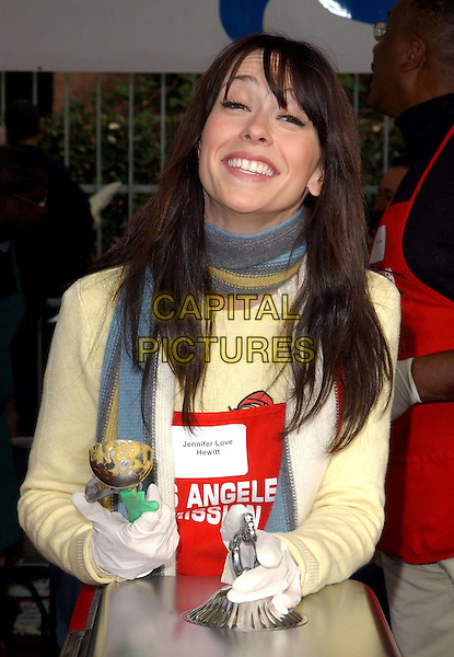 JENNIFER LOVE HEWITT.volunteer as The Los Angeles Mission Serve Up Holiday Cheer for the Homeless of Skid Row in Downtown Los Angeles, California on Christmas Eve .24 December 2003  .**UK Sales Only**      .funny face.www.capitalpictures.com.sales@capitalpictures.com.©Capital Pictures.
