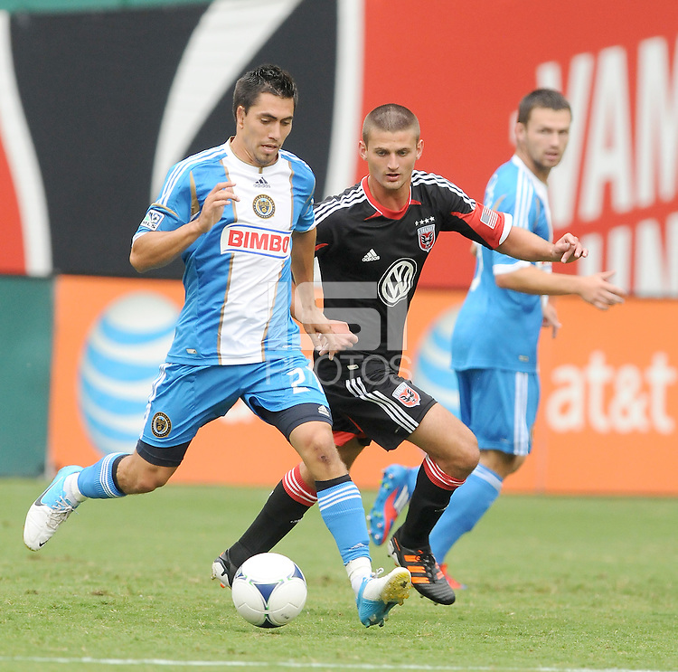 Philadelphia Union midfielder Michael Farfan (21) shields the ball against D.C. United midfielder Perry Kitchen (23) D.C. United tied The Philadelphia Union 1-1 at RFK Stadium, Saturday August 19, 2012.