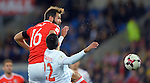 Joe Ledley of Wales is challenged by Ivan Obradovic of Serbia during the FIFA World Cup Qualifying match at the Cardiff City Stadium, Cardiff. Picture date: November 12th, 2016. Pic Robin Parker/Sportimage