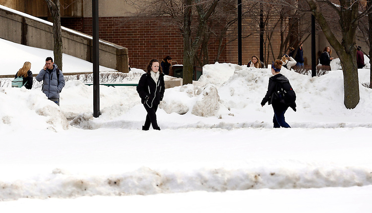 DePaul University students make their way across The Quad on the Lincoln Park Campus Tuesday, Feb. 18, 2014 following several weeks of snow fall during winter. (DePaul University / Rae Kirby)