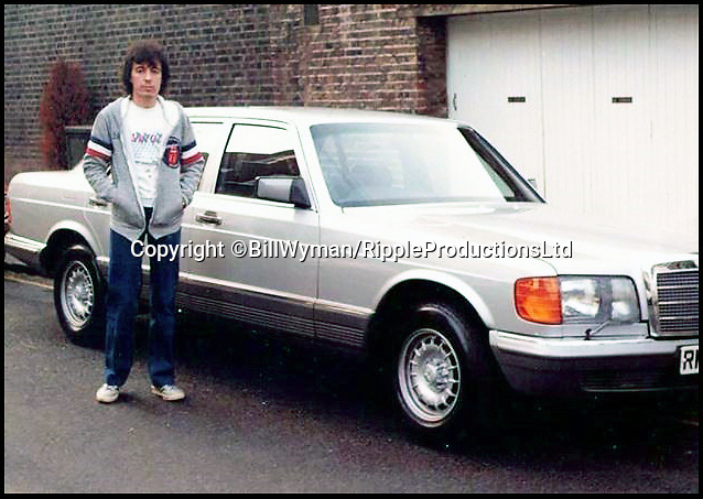 """BNPS.co.uk (01202 558833)Pic: BillWyman/RippleProductionsLtd/BNPS<br /> <br /> Bill Wyman takes delivery of his Mercedes 500 SEL 1982.<br /> <br /> A pair of vintage Mercedes belonging to Rolling Stones founder member Bill Wyman have emerged for sale for over £30,000.<br /> <br /> The 560 SEL and the 500 SEL saloon cars have been with the legendary rocker for several years and he even bought the 560 from his bandmate Mick Jagger.<br /> <br /> He has decided to part with the vehicles with a heavy heart as he says they are 'wasted' sitting in his garage.<br /> <br /> They are to sell with Omega Auctions of Newton-Le-Willows, Merseyside, who say the cars have a real 'rock star pedigree'.<br /> <br /> The 560 was bought by Wyman in 1993 when he purchased it from Jagger, who had himself owned it for three years.<br /> <br /> He sensationally quit the band later that year and used the classy saloon on his daily commute to and from his lavish home in Vence, France.<br /> <br /> The 1990 model has 136,000 miles on the clock, 40,000 of which were put on by Jagger.<br /> <br /> Wyman says that he actually owes his life to the four-door's build quality, as on one occasion his driver fell asleep at the wheel, ploughing into a motorway barrier.<br /> <br /> It has a stunning blue body, cream leather interior and celebrity-friendly tinted windows.<br /> <br /> It is powered by a whopping V12 engine but has spent most of its recent years going unused in Wyman's garage.<br /> <br /> Speaking about the German classic, the guitarist said: """"I was forever grateful for my decision to buy it, as it was a dream to drive the 14/15 hours from London to France regularly.""""<br /> <br /> The 560 SEL was bought by Wyman to replace the other Mercedes he has now decided to sell - a 1982 500 SEL.<br /> <br /> The 81-year-old has owned the car since new and covered around 115,000 miles in it, but it is now set to go under the hammer for up to £12,000.<br /> <br /> He says that back in the eighties t"""