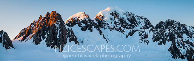 First light on second highest peak of Southern Alps, Mount Tasman 3497m on right. Mt. Lendenfeld 3194m and Mount Haast 3114m on left, Westland Tai Poutini National Park, West Coast, UNESCO World Heritage, New Zealand, NZ