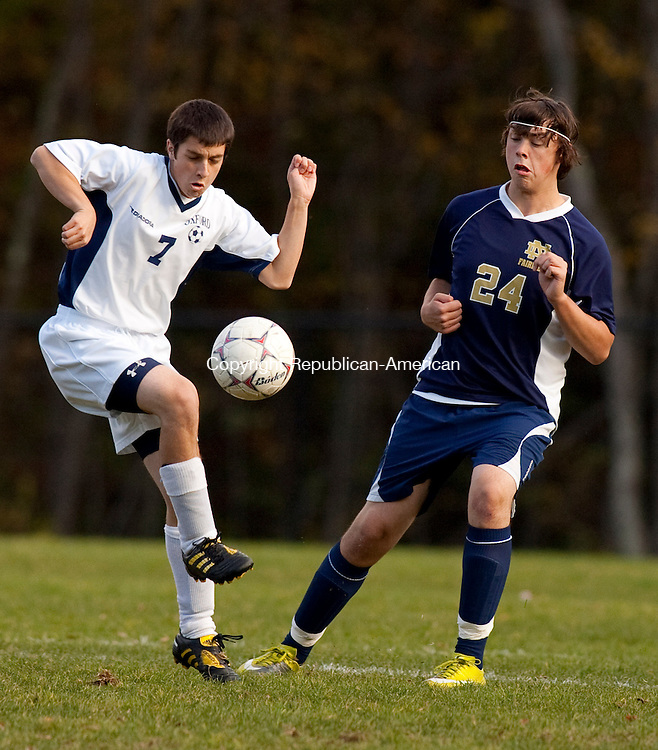OXFORD, CT, 19 OCTOBER 2010-101910JS08-Oxford's Evan Rooney (7), gets control of the ball in front of Notre Dame-Fairfield's Ryan Connolly (24) during their game Tuesday at Oxford High School. <br />  Jim Shannon Republican-American