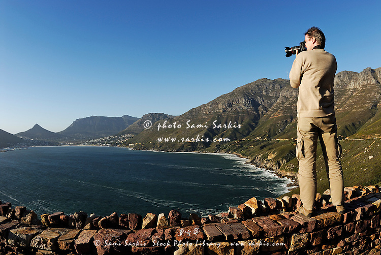 Man photographing Hout Bay, Western Cape Province South Africa