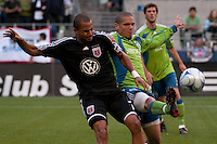 Osvaldo Alonso (r) of the Seattle Sounders fights for the ball with Fred (l) of DC United in the match played on June 17, 2009 at Quest Field in Seattle, WA. The Sounders and United played to a 3-3 draw.