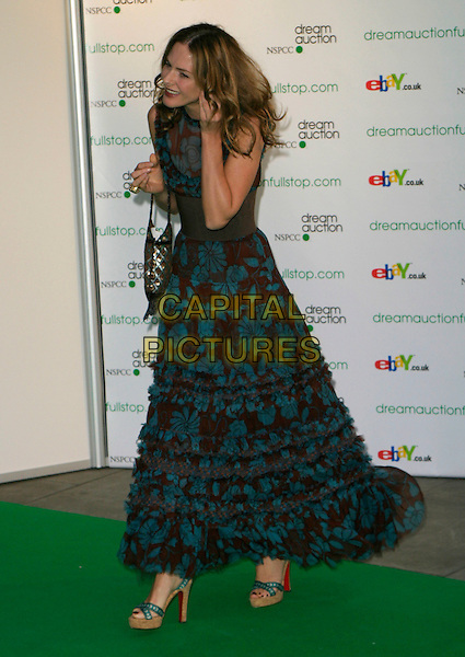 TRINNY WOODALL .At the Dream Auction Full Stop - VIP Party, primarily to launch children's charity NSPCC's There4Me online sevice. Held at the Royal Albert Hall, London, England, .May 9th 2006..full length blue and brown print patterned long dress funny hair .REf: AH.www.capitalpictures.com.sales@capitalpictures.com.©Adam Houghton/Capital Pictures.
