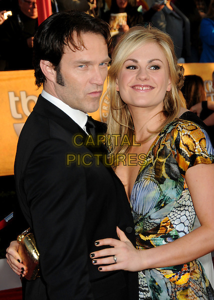 STEPHEN MOYER & ANNA PAQUIN.16th Annual Screen Actors Guild Awards - Arrivals held at The Shrine Auditorium, Los Angeles, California, USA..January 23rd, 2009.SAG SAGs half length black low cut couple print cleavage plunging neckline suit tie dress pattern printed blue snake green hand yellow clutch bag gold nail varnish polish.CAP/ADM/BP.©Byron Purvis/Admedia/Capital Pictures