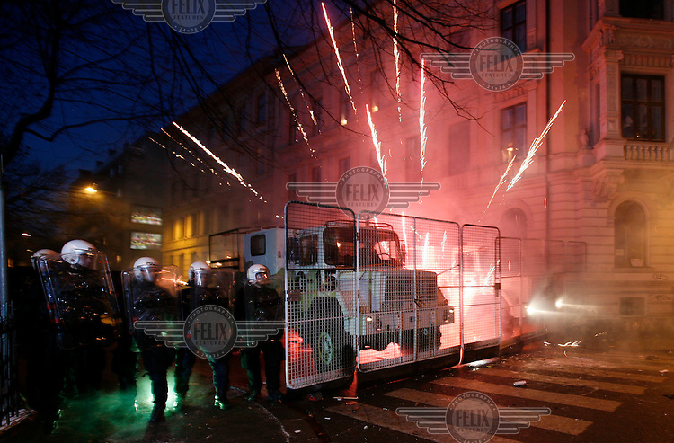 Fireworks explode between police vehicles. Pro-Palestinian protesters clashed with police as they held another demonstration against Israel in the Norwegian capital Oslo. Violent clashes lasted for hours  in the centre of Oslo. Israeli forces began a series of air strikes on the Gaza Strip on the 27th of December in retaliation against Hamas rockets fired into Israel. After eight days of bombardment, leaving over 400 Palestinians and four Israelis dead, Israeli tanks launched a ground invasion on the 4th of January.