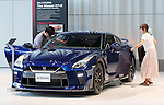 July 27, 2016, Yokohama, Japan - customers check Japanese automobile giant Nissan Motor's flagship sports car GT-R at the company's showroom in Yokohama, suburban Tokyo on Wednesday, July 27, 2016. Nissan announced the company's operating profit for the first quarter fell 9.2 percent to 175.8 billion yen since string yen and trouble of the MMC's mini car Days and Days Roox.    (Photo by Yoshio Tsunoda/AFLO) LWX -ytd-