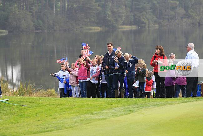 A group of supporters cheering on the players during Monday's Morning Foursomes Match 2 of the 2014 JUNIOR RYDER CUP at the Blairgowrie Golf Club, Perthshire, Scotland. <br /> Picture:  Thos Caffrey / www.golffile.ie