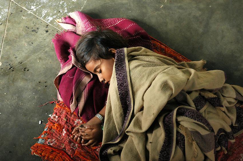 Maldhari child sleeping in her home..Michael Benanav - mbenanav@gmail.com